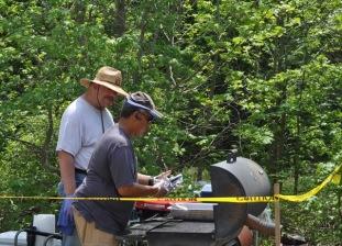 Robert and Bear cooking the hamburgers!