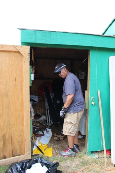 Robert Cleaning out some of the Shed.